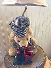 Medium sized table lamp looks amazing in a little boy's room! It has a charm and appearance of the 1980's which is cute and casual with attention to detail. The plush conductor bear has a mini blue and white conductor outfit and wooden toy train. The lamp