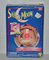1995 Sailor Moon's Sailor Locket electronic weapon! New old stock!Tested in working condition! Box has been opened to test the locket. The locket lights and sounds when opened or center button / crystal is depressed. The sound is not good quality, which