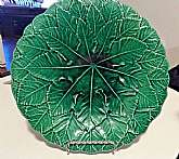 You will receive: (1) BEAUTIFUL ANTIQUE GREEN LEAF OVERLAY MAJOLICA PLATE CHARGERExtra Details: This is an antique item and has some flaws. There is crazing present and obvious flaws to be noted: 2 Cracks in the glaze, some knicks and discoloration pres