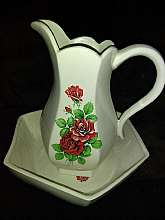 You will receive: (1) Large Yozie Mold Pitcher and Bowl w/Wash Basin, Roses Very Beautiful.Extra Details: Item is a Yozie Mold Creation and is signed on the bottom. This item is beige in color with red and green roses pattern. Very good condition, Measu