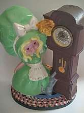You will receive: (1) Vintage Porcelain Ceramic Large Figurine and Whined Up Tick Tock ClockExtra Details: This item do have a few chips so please view photos closely. The clock has a whined up tick tock.  Approximately 11