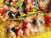 Plastic toy pigs in a cute header bag.