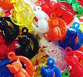 Cute and colorful plastic owl charms marked Hong Kong.