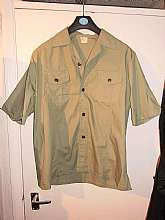 the shirt is original not a repro and in mint condition from the 1960s