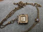 "1940s Gold Tone Photo Locket Necklace With Adjustable Chain 46"" Signed in used good condition  as seen in pics it is signed HUM a Jesus fish with antenna followed by CO Beautiful vintage piece"