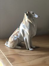 Made in the USSR, this beautiful ceramic Collie Dog figurine is in just about perfect condition for display for any collection!