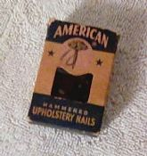 14 Vintage American Hammered Upholstery Tacks in original box.