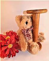 This beige stuffed plush teddy bear sitting with an old wooden bobbin will look adorable in a rustic, primitive or county farmhouse setting.  Or, as a theme decoration in a sewing room!