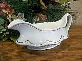 The creamy white china and the gold accents on this  Homer Laughlin Vintage 1930s gravy boat will beautify your holiday table or your china collection display.