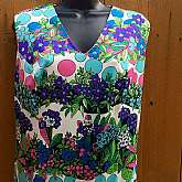 Vintage 60's Sleeveless Shift DressColor combo of blues, purples, pinks & greensBubble floral party patternV-neck cutDarted bust & midriffBack zipper closureFully linedSuper lightweight soft feel perfect for spring/summerGerman madeGreat