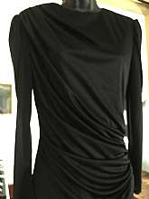 "This is a black 20s Style DressRound necklineGathered at shouldersRuched waist with swing skirtBack has a sash that also has the ruched accent at back of waist areaBack zipper closureTagged size 5Measures lying flatBust 18"" across Waist 14&q"