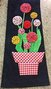 "Incredible 70's flared black denim by Cheap JeansHigh waist with flat front and back Adorable Gingham plaid flower pot with bouquet of flowers applique on both legsExtra wide bellMeasures lying flatwaist 26""hips 34""rise 8""inseam 31&"
