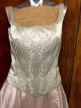 Gorgeous Vintage Silver Corset Bodice With Pink Sheer Lining Evening Gown/Wedding Dress Fitted corset bodice in silver color with silver embroidered floral detailing. Inner boning for shape and support rosette oBasque (V-dip) waist Full sweep sheer or