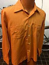 "60s -Mr. Sir- Mens solid orange , Mod long sleeve dress shirt with front button closure and 2 matched patch pocketstagged size large Measures lying flatchest pit to pit 21"" = 42"" totalsleeves 23""length shoulder to hem 24 1/2""Good"