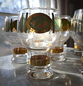 Athena and Cherub motiff on green. Footed beer glasses. 22kt gold accents. Extremely rare.