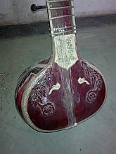 rose wood colour of veena .. an musical instrument