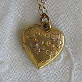 Beautiful vintage gold filled engraved heart flower locket that measures 1/2 inch and is hung on a dainty 15 1/2 inch chain.  The locket is engraved with a flowers and leaves on the top.  It is the perfect classic edition for any bride on her wedding day