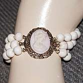 Beautiful vintage 3 row wide angelskin coral cameo clasp bracelet in the palest angelskin coral color.  It measures 1 1/8