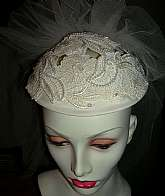 Beautiful vintage flower lace headpiece cap and veil made in the late 80s early 90s.  The cap has cutout floral bridal lace that has been embellished with sequins and pearl beads.  The veil is 5 tiered, has a ruffled top and measures about 19 inches from