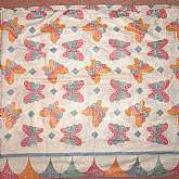 Vintage comforter or feather bed cover in a pretty glazed cotton calico fabric.  The motif is lovely; floral butterflies and polka dots.  Measures 71 wide by 72 long and must have been custom made for a specific featherbed in the old days.  It is in prist