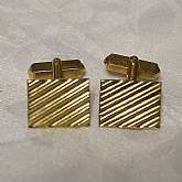 "Fabulous vintage gold plated ribbed cuff links by Swank. The cuff links are in great vintage condition and measure 5/8"".  We gladly accept reasonable offers on all of our merchandise."