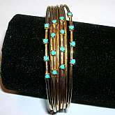 Fabulous vintage faux turquoise aqua rhinestone multi wire bangle bracelet. It has lovely aqua rhinestones in prong settings and the wires are banded together at the bottom. About 3/4 inches wide and 2 5/8 inches across.