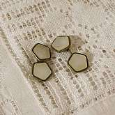 Vintage Art Deco mother of pearl cuff links with rolled gold or gold filled setting with silver tone top. The cuff links are in wonderful vintage condition with some light patina normal for their age. Measures a little over 1/2