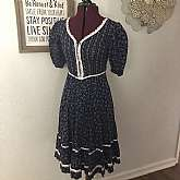 Beautiful vintage navy blue and white handmade Gunne Sax  corset ruffled Prairie hippie dress.  It is well-made and about a size 3/4 with short puffed sleeves and wide swing skirt with double ruffle. The dress measures bust 32 waist 27 hips free and lengt