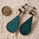 Vintage Mexican sterling inlaid turquoise earrings that are screwbacks. They are stamped
