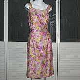 Mod vintage 50s handmade cotton Hawaiian sheath wiggle dress or sundress with pretty floral fabric. We believe the fabric is rayon or polished cotton. The dress is hourglass but loose fitted however it still manages to accentuate the body as the photos sh