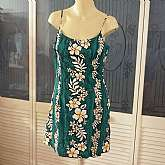 Great vintage Hawaiian floral cotton sundress dress by Royal Creations in green, white and yellow.  It is really fun and cute, perfect for festivals like Coachella and EDC. It is tagged XL by vintage standards but is smaller by today's; probably a size 8/