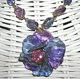 One of a kind Indie wire wrapped r, wire wrapped Amethyst gemstone beads and vintage art glass crackle beads. It is so feminine and beautiful on and much better than the photos portray.  Measures 17 inches plus 1 3/4 additional on the flower.