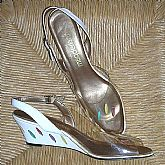 Vintage California Magdesians applique  slingback shoes in clear plastic and leather.  They are platform wedges with leather \lLeaves appliqued on the tops and on the heels. They are multicolor on the clear plastic and white leather in red, yellow, purple