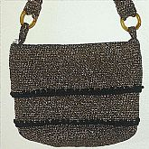 Retro 60s vintage gold metallic purse handbag that is either knitted or crocheted.  It is made from a woven fiber with gold metalic and black threads. It is very heavy, has a layered design. Measures 10 x 7 1/2 and is in excellent condition.