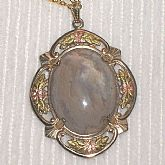 Gorgeous Antique Victorian Moss Agate Pendant Necklace in gold filled setting.  The gemstone cabochon which I am pretty sure is Moss Agate, is set in a a filigree setting.   The applied decoration looks like rose and green gold but hasn't been tested.  Th