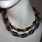 This beautiful Trifari two toned black and gold metal necklace is really sharp.   It is a double strand twisted curb chain and measures about 17 inches.  Pristine unworn condition.