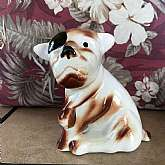 Vintage Ceramic Dog with Patch Over One Eye Brown White - 1940's. Item is it not marked but I believe it was made in Japan.  Measures 5 3/4 inches tall x 5 inches wide x 2 3/4 inches, Thi ceramic dog is brown and white with a black patch over one eye.