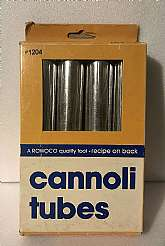 This Vintage Set of 4 Rowoco Cannoli Tubes model #1204 looks to have never been used. The pastry tubes are in their original box which has a recipe for Cannoli Shells and Filling on the back. The box shows signs of wear but is in GOOD condition.  Th