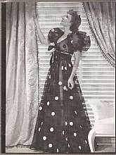 Vintage Media Image of Claudette Colbert in a gown designed by Travis Batten for