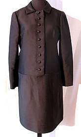 This 1960's piece is in near mint condition, You would think that it had been made yesterday.  Custom made for Marshall Field's legendary couture 28 Shop in Chicago, the coatdress is made of black silk faille. It's design, though one piece, looks part sui