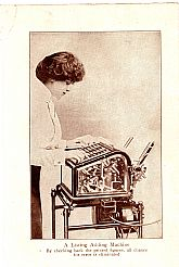 Framed photo plate of the view of a woman operating a listing adding machine (circa 1914)