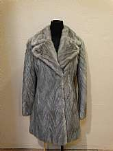 This is a beautiful Coat. They don't make them like this anymore. It is gray in color and abolutely stunning. Again a Big LT is monogrammed inside...wonder who she was, was she well known? famous? Gray in color. This is a size small....i only wish i was s