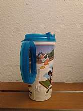 It is 7 in tall, 3 1/4 in round. It has a translucent blue lid and handle. This plastic thermo mug has Minnie Mouse, Donald Duck, Goofy, Pluto, Daisy, and Mickey Mouse relaxing around a pool. It has