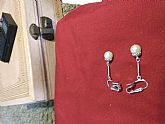 Silver tone and pearl accent earrings