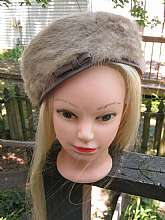 This is a very nice winter formal hat.  It's sides are mink and the top and trim is, I think, a satin material.  The hat is a light beige fur.  It's very clean inside.  The inside circumference is  21 1/2 inches.  The hat is a Darcel Exclusive.