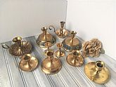 This listing is for a Lot of 10 Brass Candle Holders with Handles. Range in sizes. Instant Collection.