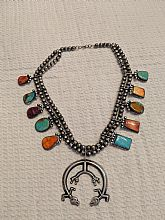 Beautiful Silver with turqoise and other colored stones necklace. Bought in New Mexico in the 1980's. Not sure of designer, hand made bought in a market.