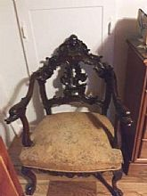 Parlor chair carved reportedly from rosewood.