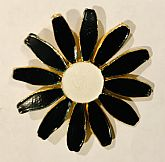 This 70s daisy is stamped Accessocraft in the back. The front is black & white enamel. It is from old dead stock & never been worn. Condition is excellent. 