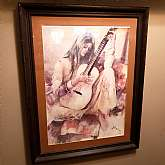 Vintage Boho Wood Framed Wall Art Lithograph Girl with Guitar Irene Borg 1970's large print decorHard to Find Print from Irene Borg.  Beautiful and relaxing print of a girl and her guitar.Brown earth tones and framed in a nice wood frame.Minor wear